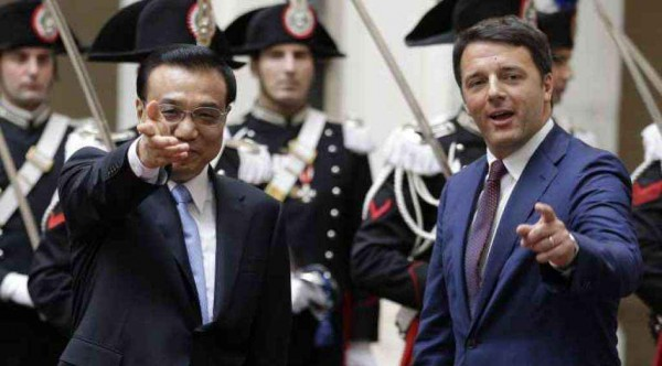 Italian Prime Minister Renzi gestures next to China's Premier Li as they arrive for a meeting at Chigi Palace in Rome